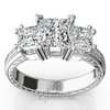 Antique engraved three stone engagement ring